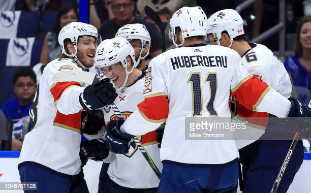 Jacob MacDonald of the Florida Panthers celebrates a goal in the first period during Opening Night against the Tampa Bay Lightning at Amalie Arena on...