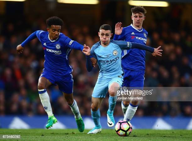Jacob Maddox of Chelsea and Mason Mount of Chelsea put pressure on Matt Smith of Manchester City during the FA Youth Cup Final second leg between...