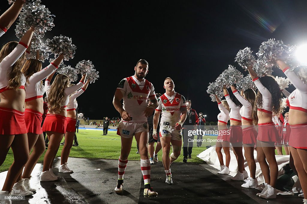 Jacob Marketo of the Dragons and Euan Aitken of the Dragons leave the field after winning the round 10 NRL match between the St George Illawarra Dragons and the Canberra Raiders on May 12, 2016 in Sydney, Australia.