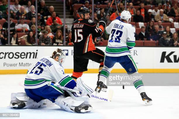Jacob Markstrom and Alexander Edler of the Vancouver Canucks defend against Ryan Getzlaf of the Anaheim Ducks during the first period of a game at...