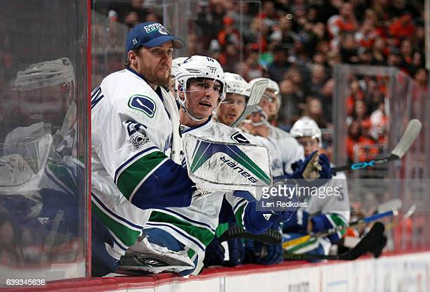 Jacob Markstrom and Alexandre Burrows of the Vancouver Canucks react on their bench following a second period goal against the Philadelphia Flyers on...