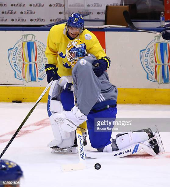 Jacob Markstrom has a laugh with Loui Eriksson of Team Sweden at practice during the World Cup of Hockey 2016 at Air Canada Centre in Toronto Ontario...