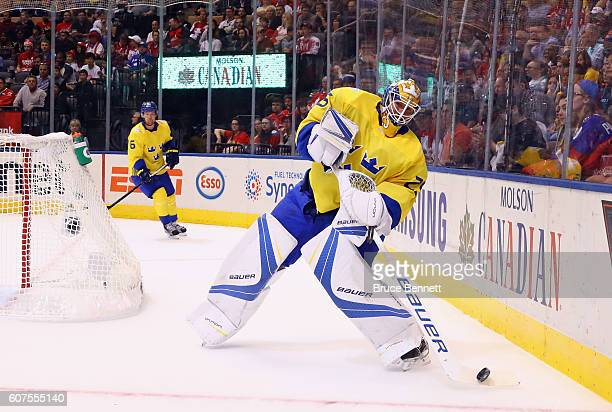 Jacob Markstrom of Team Sweden clears the puck during the first period against Team Russia during the World Cup of Hockey 2016 at the Air Canada...