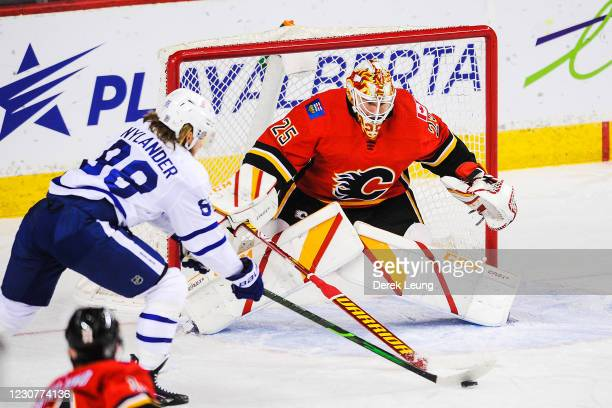 Jacob Markstrom of the Calgary Flames stops a shot from William Nylander of the Toronto Maple Leafs during an NHL game at Scotiabank Saddledome on...