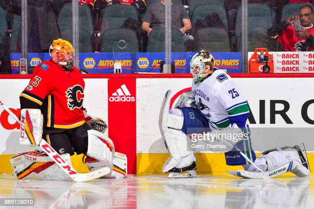 Jacob Markstrom of the Vancouver Canucks and David Rittich of the Calgary Flames chat at warm up in a NHL game against the Vancouver Canucks at the...