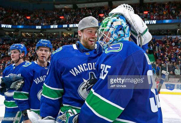 Jacob Markstrom of the Vancouver Canucks congratulates teammate Thatcher Demko after their NHL game against the Columbus Blue Jackets at Rogers Arena...