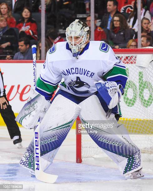 Jacob Markstrom of the Vancouver Canucks in action against the Calgary Flames during an NHL game at Scotiabank Saddledome on October 6 2018 in...