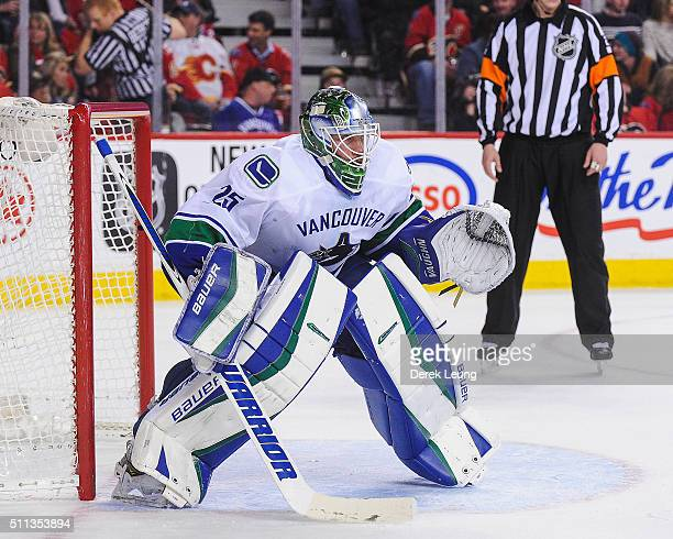 Jacob Markstrom of the Vancouver Canucks in action against the Calgary Flames during an NHL game at Scotiabank Saddledome on February 19 2016 in...