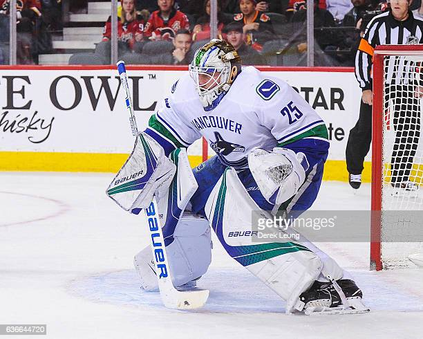 Jacob Markstrom of the Vancouver Canucks in action against the Calgary Flames during an NHL game at Scotiabank Saddledome on December 23 2016 in...