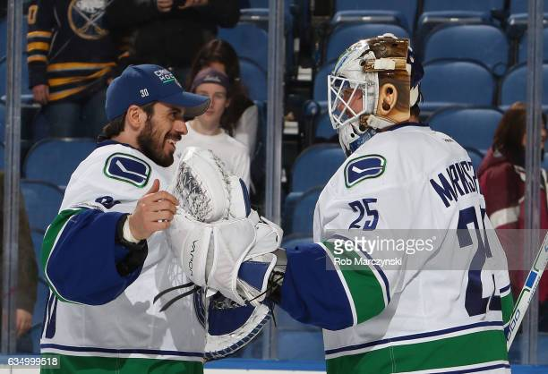 Jacob Markstrom of the Vancouver Canucks is congratulated by Ryan Miller after their 42 victory against the Buffalo Sabres during an NHL game at the...