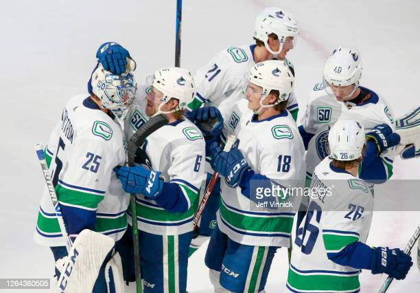 Jacob Markstrom of the Vancouver Canucks is congratulated by teammate Brock Boeser after Markstrom recorded his first career shutout with the 3-0 win...