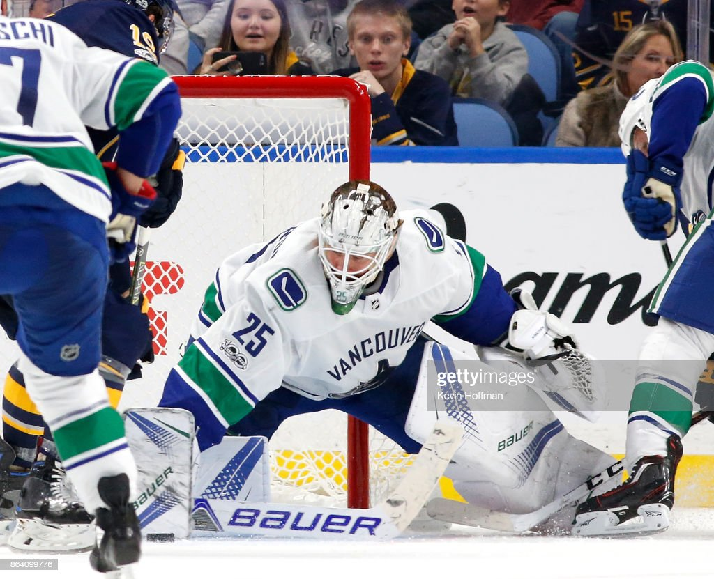 Jacob Markstrom #25 of the Vancouver Canucks makes a pad save on a Buffalo Sabres shot during the third period at the KeyBank Center on October 20, 2017 in Buffalo, New York. Canucks beat the Sabres 4-2.