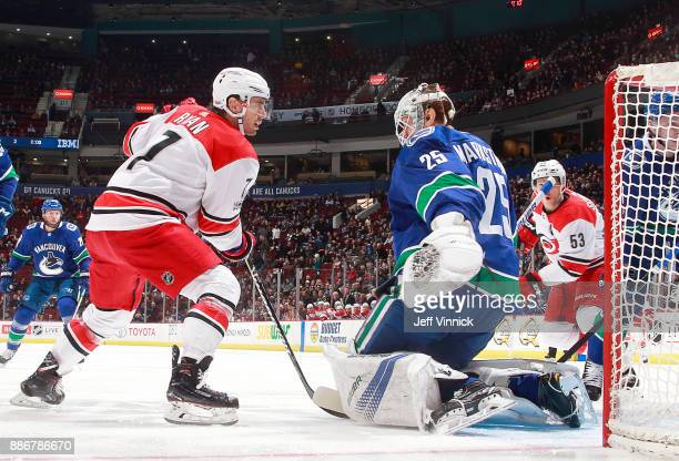 Jacob Markstrom of the Vancouver Canucks makes a save off the shot of Derek Ryan of the Carolina Hurricanes during their NHL game at Rogers Arena...