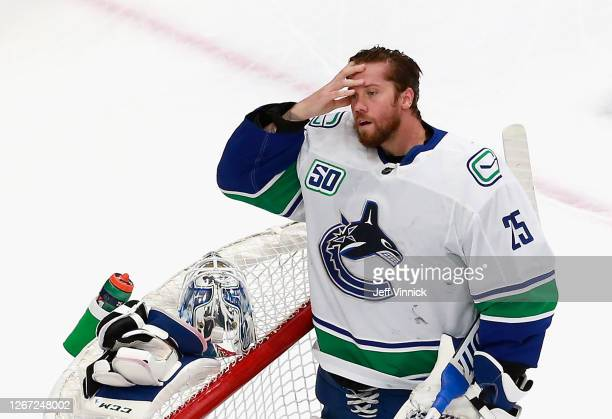 Jacob Markstrom of the Vancouver Canucks pauses following giving up a goal to Brayden Schenn of the St. Louis Blues at 15:41 of the first period in...