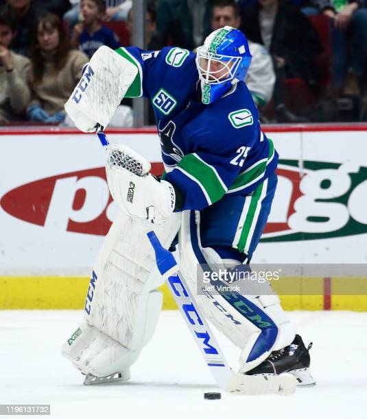 Jacob Markstrom of the Vancouver Canucks plays the puck during their NHL game against the Edmonton Oilers at Rogers Arena December 23 2019 in...