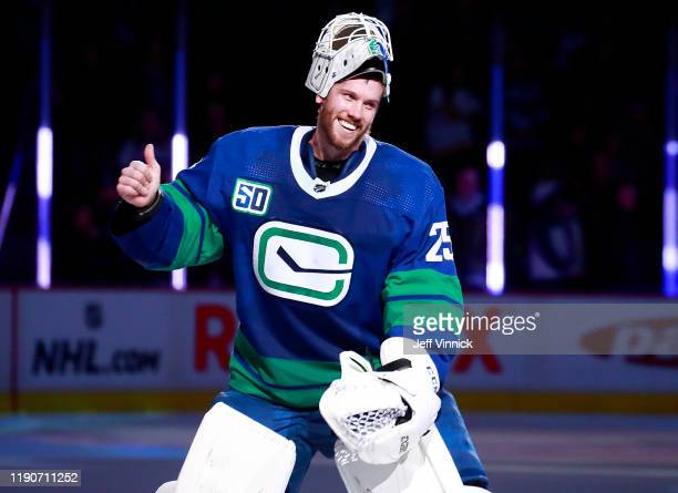 Jacob Markstrom of the Vancouver Canucks smiles after being named first stat during their NHL game against the Los Angeles Kings at Rogers Arena...