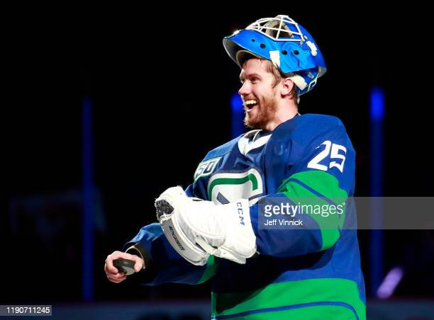 Jacob Markstrom of the Vancouver Canucks smiles at his brother after being named first star after their NHL game against the Los Angeles Kings at...