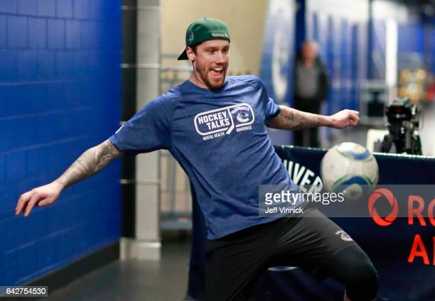 Jacob Markstrom of the Vancouver Canucks sports a Hockey Talks tshirt as he warms up before their NHL game against the Calgary Flames at Rogers Arena...