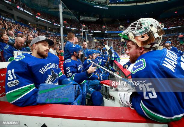 Jacob Markstrom of the Vancouver Canucks talks to teammate Anders Nilsson during their NHL game against the Ottawa Senators at Rogers Arena October...