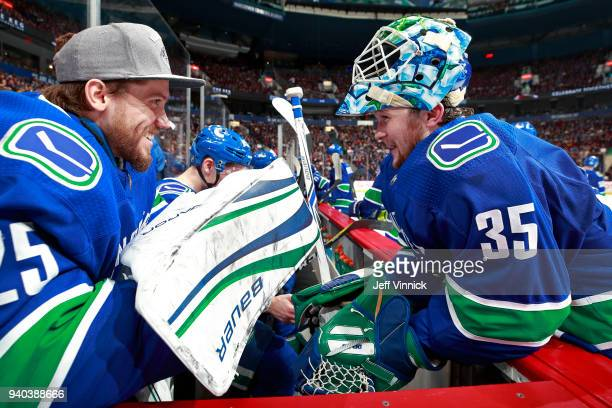 Jacob Markstrom of the Vancouver Canucks talks to teammate Thatcher Demko during their NHL game against the Columbus Blue Jackets at Rogers Arena...