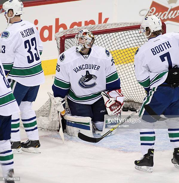 Jacob Markstrom of the Vancouver Canucks warms up on the ice before an NHL game against the Winnipeg Jets at the MTS Centre on March 12 2014 in...