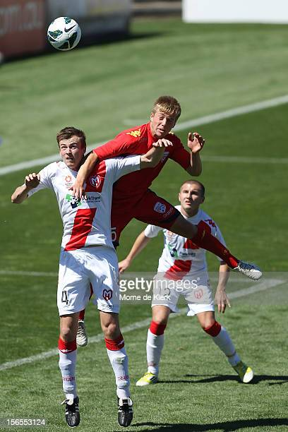 Jacob Melling of Adelaide gets up over Andrew Mullett of Melbourne during the round five Youth League match between Adelaide United and Melbourne...
