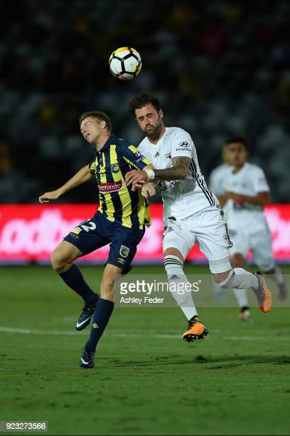 Jacob Melling of the Mariners contests the ball against Thomas Doyle of the Phoenix during the round 21 ALeague match between the Central Coast...
