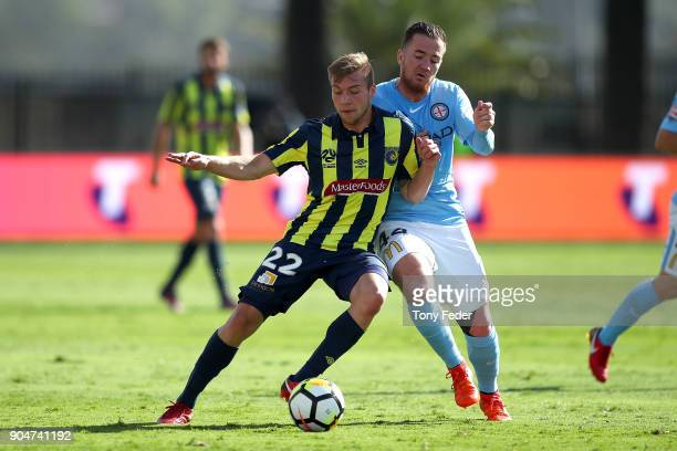 Jacob Melling of the Mariners contests the ball with Ross McCormack of City during the round 16 ALeague match between the Central Coast Mariners and...