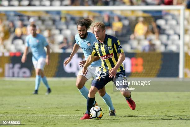 Jacob Melling of the Mariners is contested by Osama Malik of Melbourne City during the round 16 ALeague match between the Central Coast Mariners and...