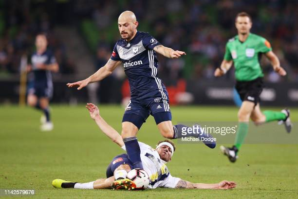 Jacob Melling of the Mariners tackles James Troisi of the Victory during the round 25 ALeague match between Melbourne Victory and the Central Coast...