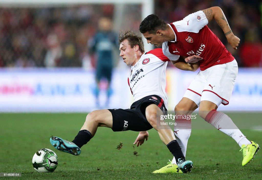Jacob Melling of the Wanderers is challenged by Granit Xhaka of Arsenal during the match between the Western Sydney Wanderers and Arsenal FC at ANZ Stadium on July 15, 2017 in Sydney, Australia.