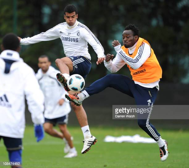 Jacob Mellis and Michael Essien of Chelsea during a training session at the Cobham Training ground on October 15, 2010 in Cobham, England.