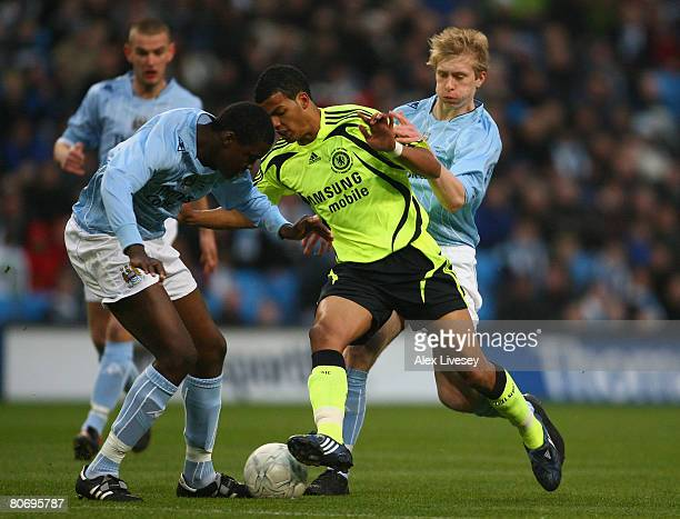 Jacob Mellis of Chelsea runs between Dedryck Boyata and Ben Mee of Manchester City on his way to scoring the opening goal during the FA Youth Cup...