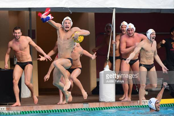 Jacob Mercep of the Southern California Trojans jumps into the pull after defeating the Stanford Cardinal during the Division I Men's Water Polo...