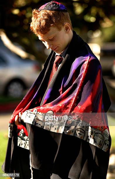 Jacob Merkin of Claremont adjusts Tallit prayer shawl before entering Temple Beth Israel in Pomona for a morning service for Jewish holiday Rosh...
