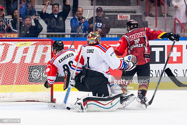 Jacob Micflikier of Lulea Hockey gets the puck in goal behind Benjamin Conz Goaltender of FribourgGotteron during the Champions Hockey League group...