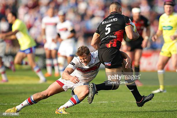 Jacob Miller of Wakefield Wildcats tackles Danny Williams of Bradford Bulls during the Million Pound Game between Wakefield Wildcats and Bradford...