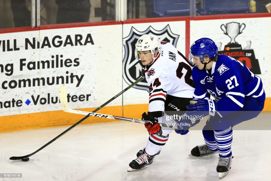 Jacob Moverare #27 of the Mississauga Steelheads battles with Liam Ham #24 of the Niagara IceDogs during the second period of an OHL game at the Meridian Centre on November 25, 2017 in St Catharines, Ontario, Canada.