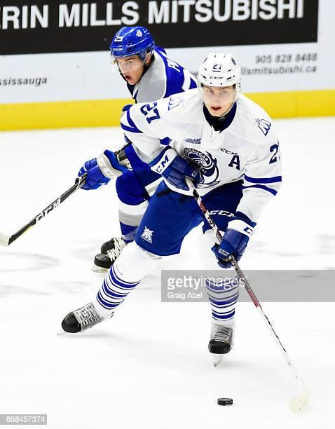 Jacob Moverare of the Mississauga Steelheads controls the puck against Darian Pilon of the Sudbury Wolves during game action on October 6 2017 at...