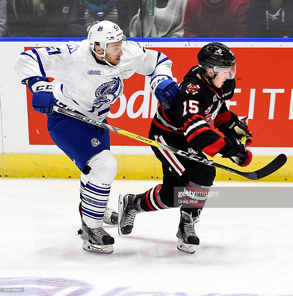Jacob Moverare #27 of the Mississauga Steelheads puts a grab on Oliver Cattleman #15 of the Niagara IceDogs during game action on October 21, 2016 at Hershey Centre in Mississauga, Ontario, Canada.