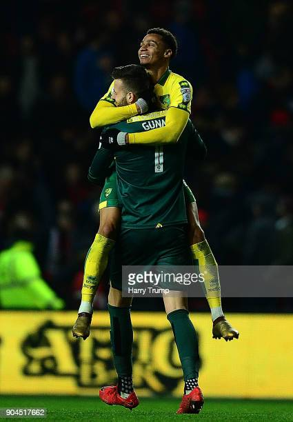Jacob Murphy and Angus Gunn of Norwich City celebrate victory during the Sky Bet Championship match between Bristol City and Norwich City at Ashton...