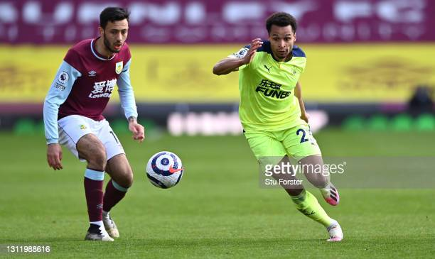 Jacob Murphy of Newcastle beats Dwight McNeil of Burnley to the loose ball during the Premier League match between Burnley and Newcastle United at...