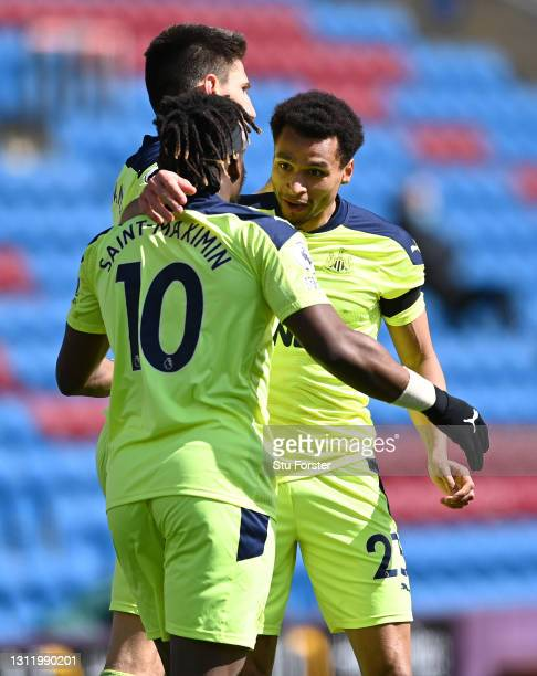 Jacob Murphy of Newcastle celebrates his goal with Allan Saint-Maximin during the Premier League match between Burnley and Newcastle United at Turf...