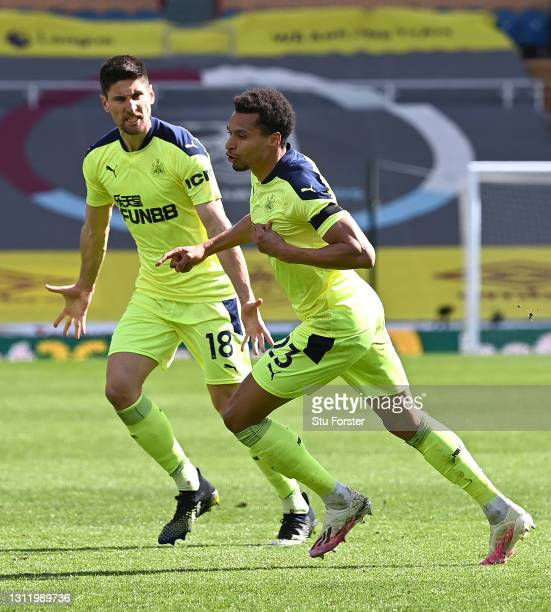 Jacob Murphy of Newcastle celebrates his goal with Federico Fernandez during the Premier League match between Burnley and Newcastle United at Turf...