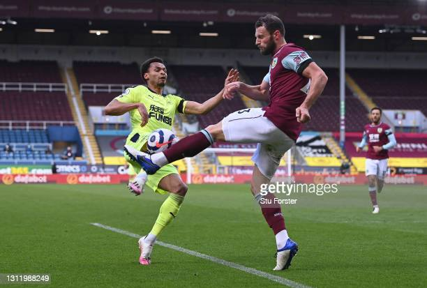 Jacob Murphy of Newcastle is challenged by James Tarkowski of Burnley during the Premier League match between Burnley and Newcastle United at Turf...
