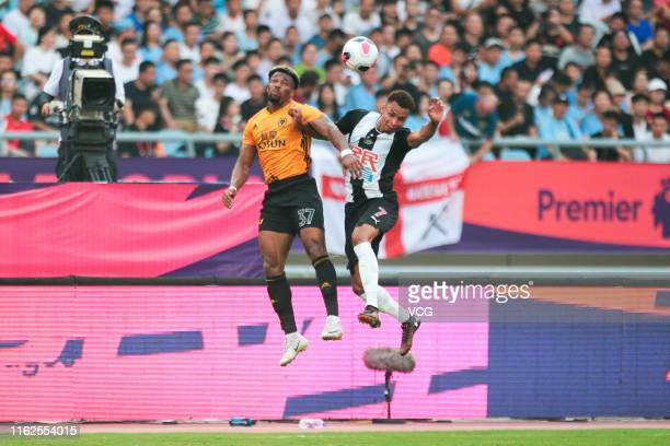 Jacob Murphy of Newcastle United and Adama Traore of Wolverhampton Wanderers compete for the ball during Premier League Asia Trophy match between...