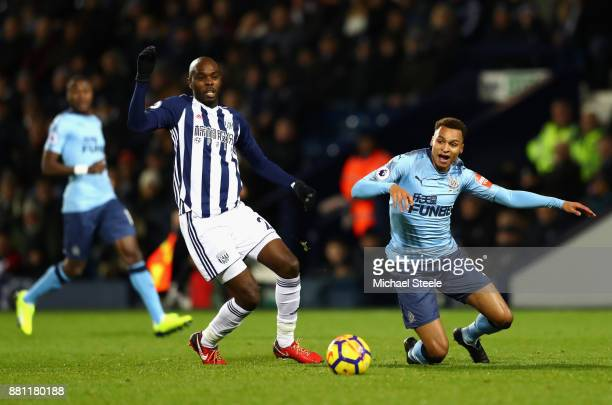 Jacob Murphy of Newcastle United and Allan Nyom of West Bromwich Albion during the Premier League match between West Bromwich Albion and Newcastle...