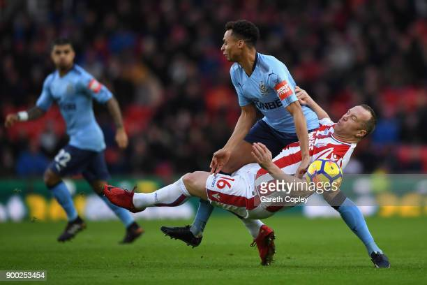 Jacob Murphy of Newcastle United and Charlie Adam of Stoke City in action during the Premier League match between Stoke City and Newcastle United at...