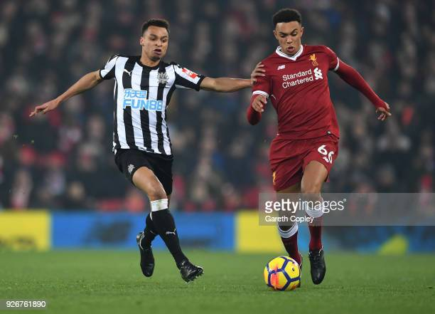 Jacob Murphy of Newcastle United chases down Trent Alex Arnold of Liverpool during the Premier League match between Liverpool and Newcastle United at...