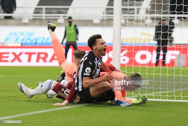Jacob Murphy of Newcastle United collides with Illan Meslier of Leeds United during the Premier League match between Newcastle United and Leeds...